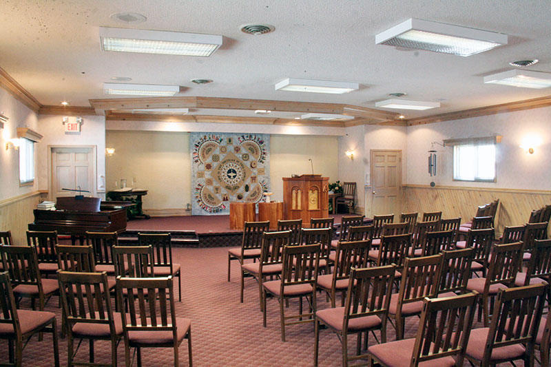 The Sanctuary is a large room equipped with folding chairs, tables, a piano, sound system, projector and screen.